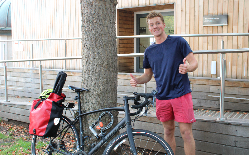 Photograph of student cycling