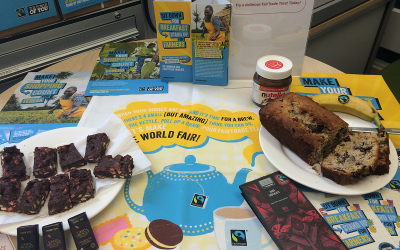 Photo of a Fairtrade Display with cakes, promotional materials and chocolate