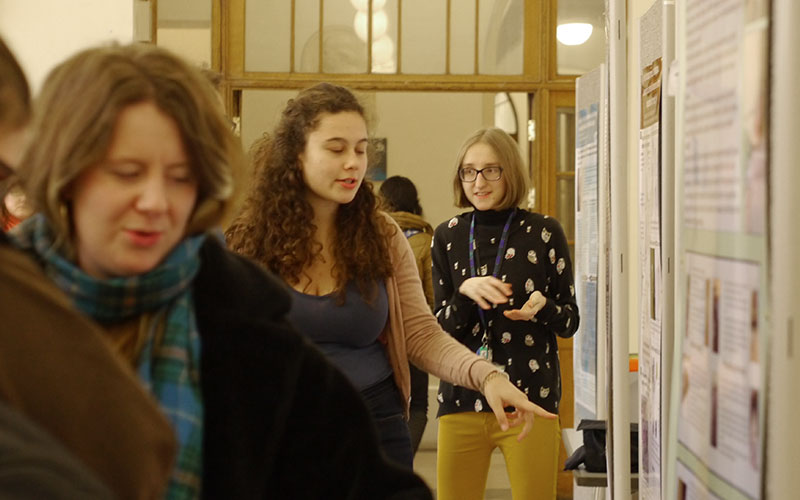 Students present their posters in the Cloisters