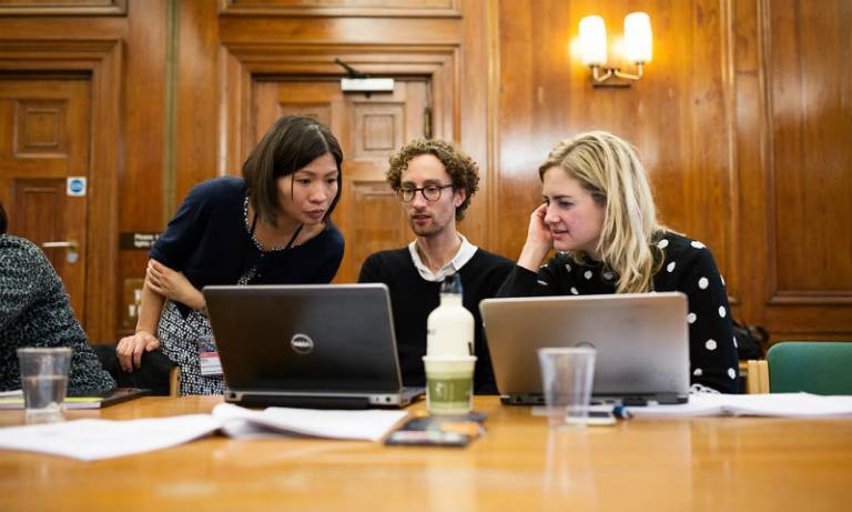 Student and staff looking at a laptop