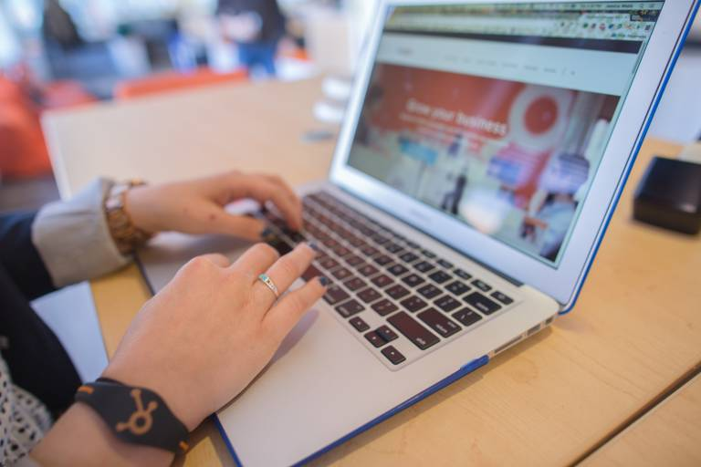 hands typing at computer