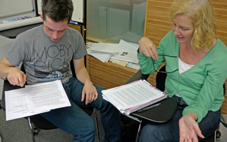A student discusses work with their tutor at UCL