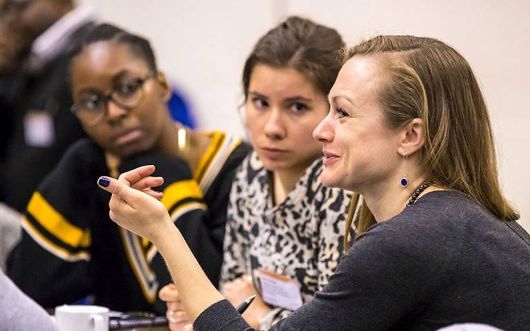 Students at UCL talking in a meeting