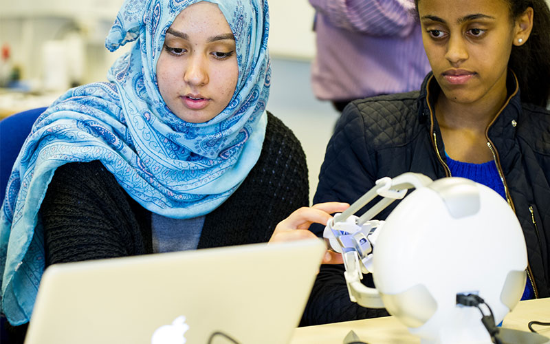 Students using computer and technology