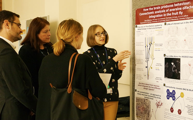 A student presents her poster on behaviour to the UCL judging panel
