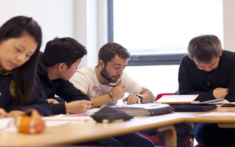 Students talking in a workshop