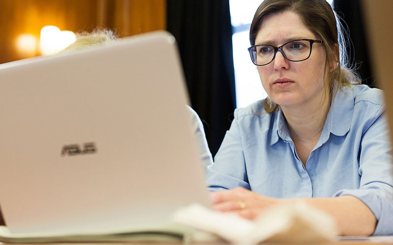 A woman on a computer at UCL