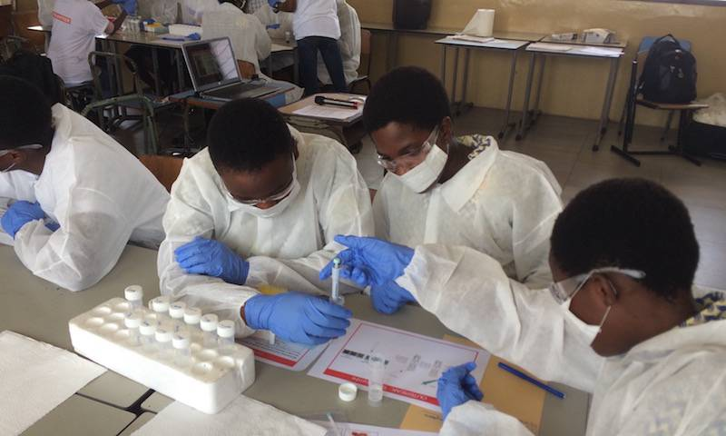 "Students participating in Lucy's 'Outbreak!"" activity in Ghana, May 2019"