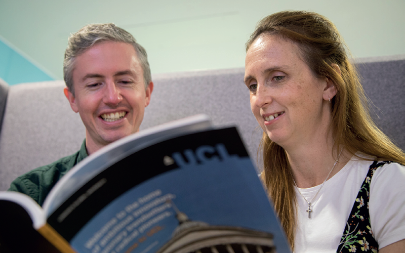 Image of two staff members reading the Career Framework booklet