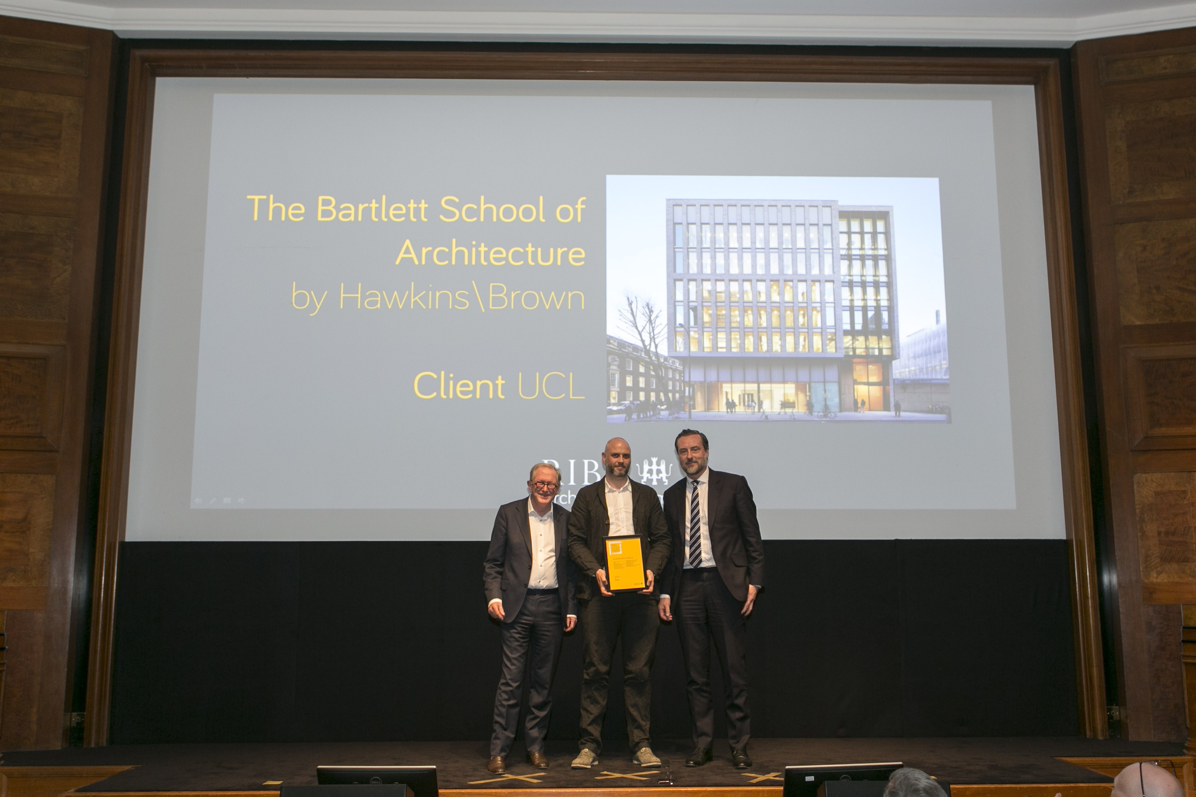 Kevin Argent and Euan Macdonald collect RIBA award for 22 Gordon Street. Image credit: Agnese Sanvito