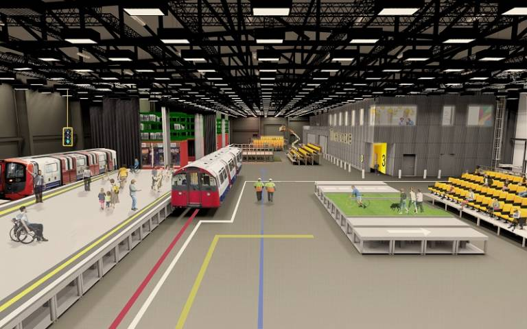 A hanger with an adjustable flooring and a single tube train carriage. An office space is on the left overlooking the main area