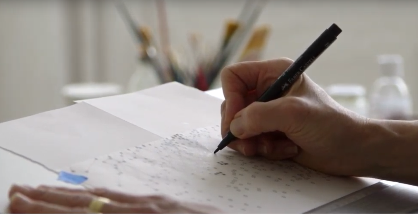 hand drawing dots on paper