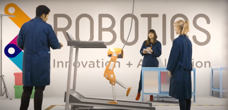 Still of UCL East flythrough video, showing a robot arm in CGI