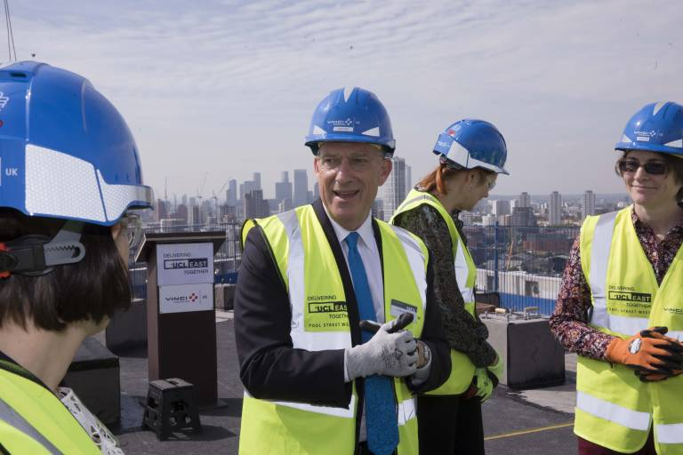 Photo of President and Provost Dr Michael Spence at the top of Pool Street West for the topping out ceremony of UCL East