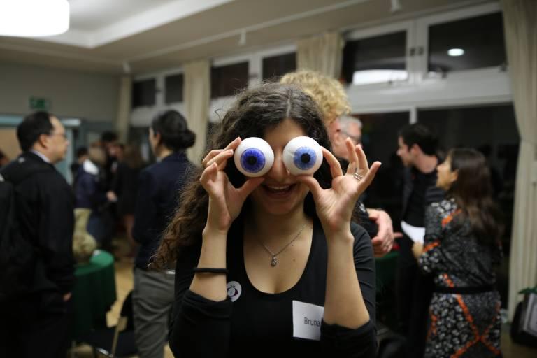 Female festival participant holds fake eyeballs