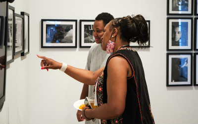 Two people looking at an art exhibition.