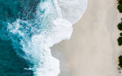 Waves breaking on a sandy beach. View from the air.