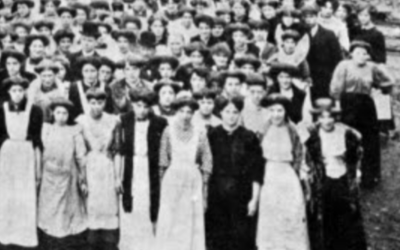 Archive black and white photograph of women standing in a crowd.