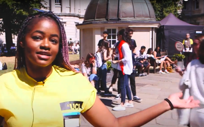 Student ambassador in yellow top guides prospective students on UCL open day.