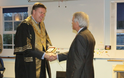 Master of the Clockmakers, Mark Elliott, presented the Clockmakers' Shield of Arms to the President and Provost of UCL