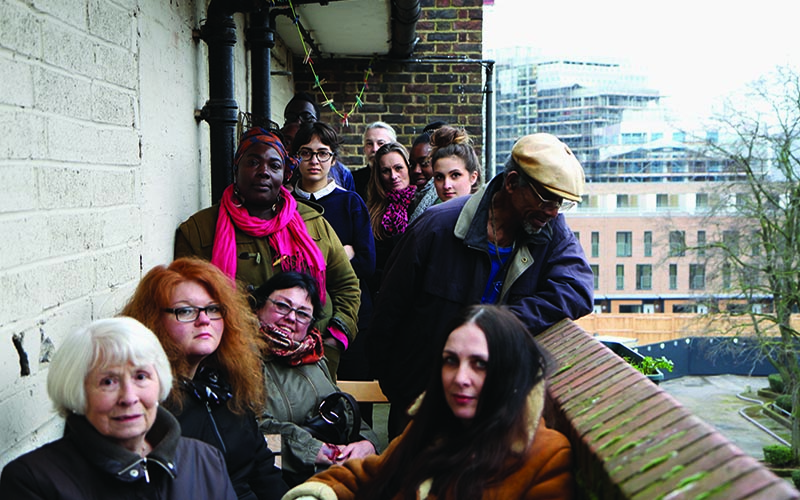 Engaged Urbanism, 'Ninth workshop on the balcony of Samuel House performing the history of public housing in London', Credit: Fugitive Images