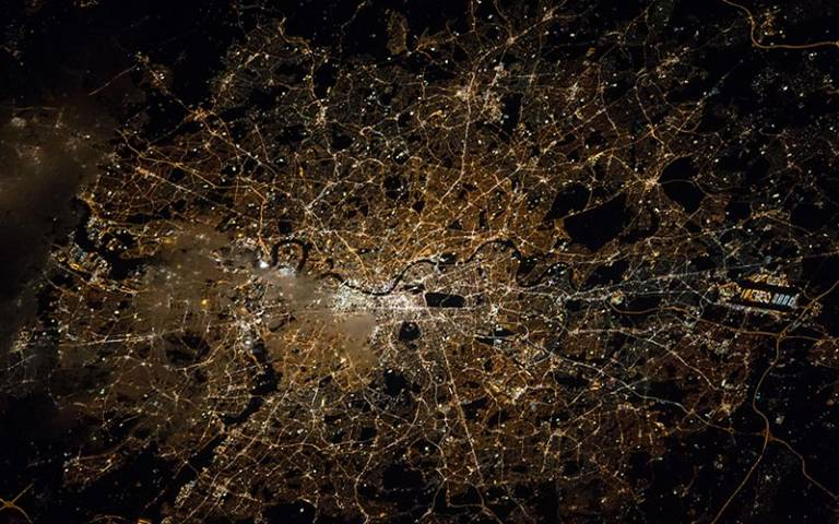 London at night from above (Credit: NASA/Tim Kopra) used under Attribution-NonCommercial 2.0 Generic (CC BY-NC 2.0) from Wikimedia Commons.