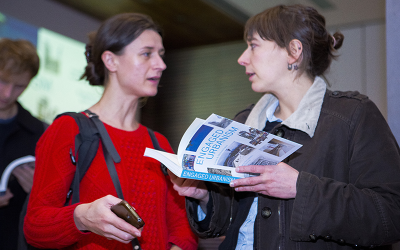 A person holds a copy of the book 'Engaged Urbanism: Cities and Methdologies'