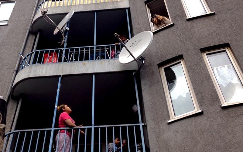 Women talking on balconies in Templehof, Berlin, by Jonah Rudlin