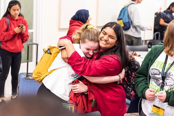Students hug at the end of summer school