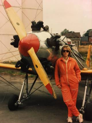 Claire Glen standing next to plane
