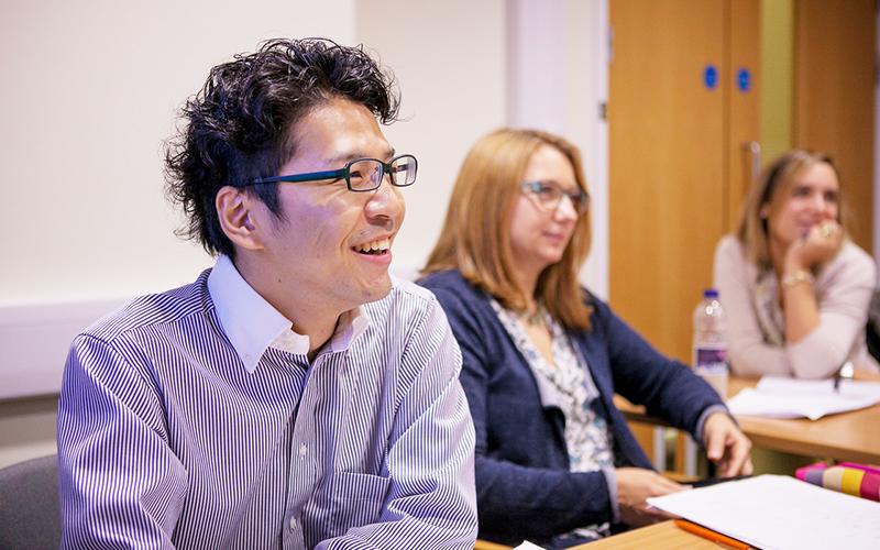 Three members of staff smiling