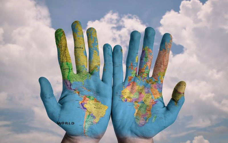 Hands with an image of the world map on them