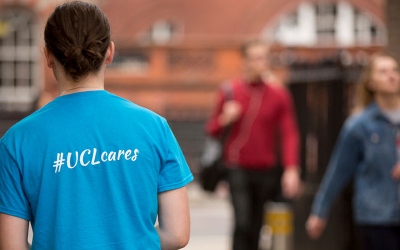 A UCL helper wearing a UCL Cares T-shirt